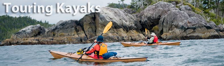 paddling in touring kayaks