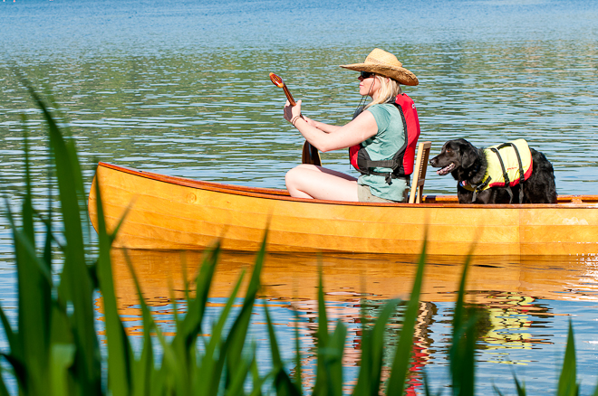 canoest with paddle and dog