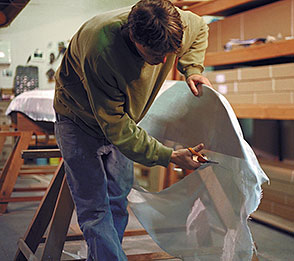 fiberglassing the kayaks hull