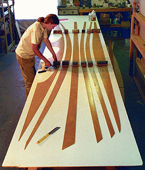 glue the wooden panels to their full length