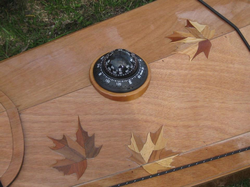 Beth Stewart laminated maple leaves cut out of veneer onto her Arctic Tern.