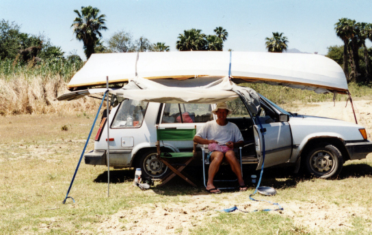 "Martin Ziebell with ""Pywiak"", his Wineglass Wherry cartopped on his Toyota Tercel."